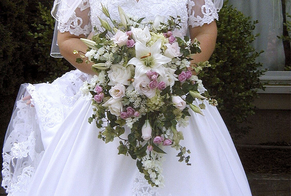 wedding-bride-with-bouquet-white-lily-cascade