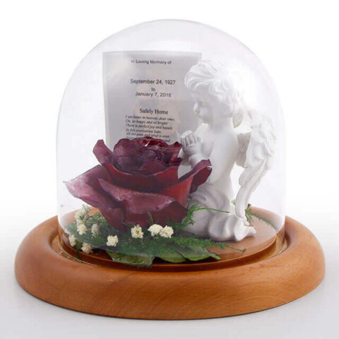 "Sympathy keepsake in a 5.5"" dome."