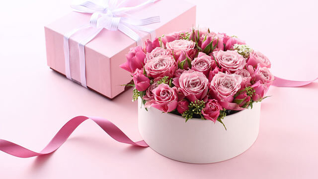 A flower arrangement in a gift box