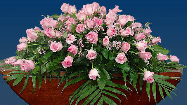Sympathy flower arrangement with pink roses