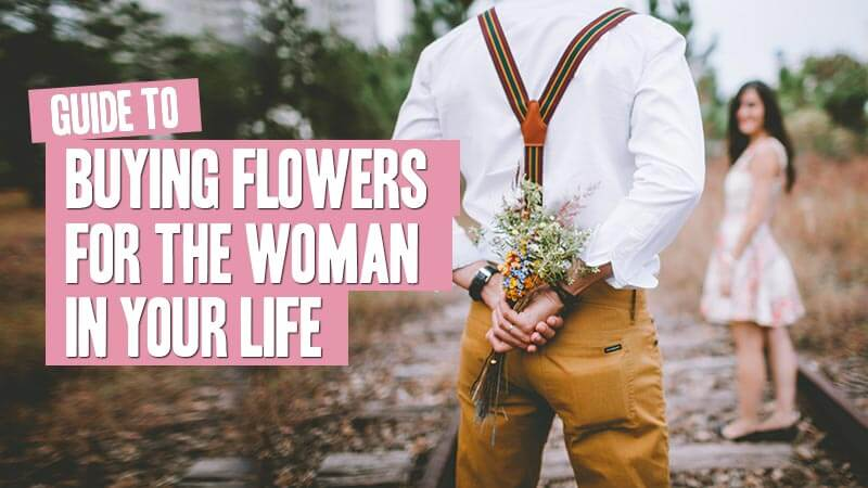 Man with bouquet behind his back to surprise a woman