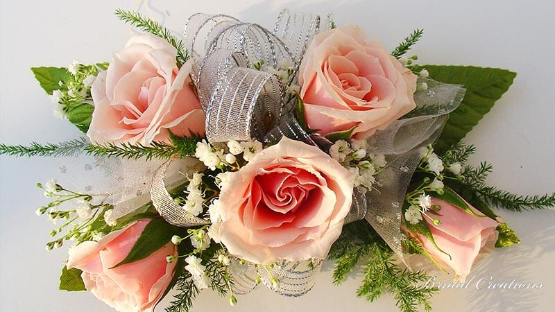 Corsage with pink roses and ribbon